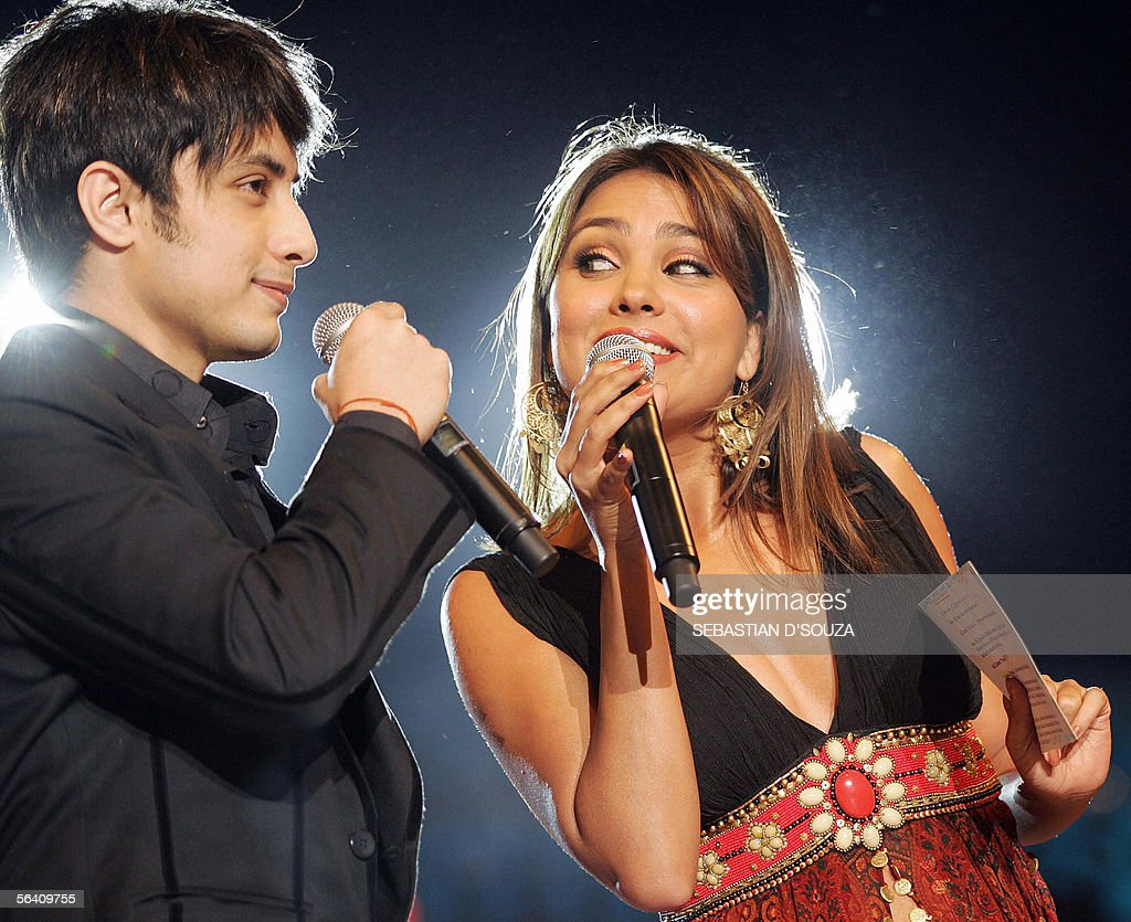 Indian actress Lara Dutta and Pakistani pop star Ali Zafar perform at the MTV IMMIES held in support of relief activities for the victims of the...