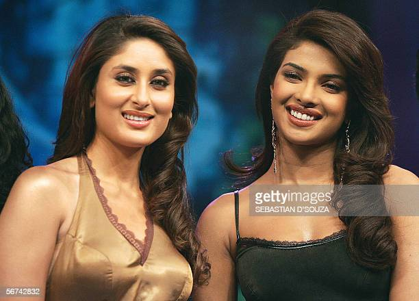 Indian cinema actresses Kareena Kapoor and Priyanka Chopra psoe for photographers on the set of the 'Indian Idol' television programme in which they...