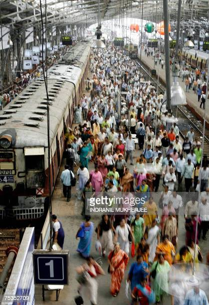 Indian commuters alight from a suburban train at the Churchgate railway station in Mumbai 11 July 2007 India marks the first anniversary of its worst...