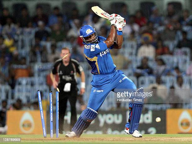 Mumbai Indian batsman Kieron Pollard being bowled by Somerset bowler Alfonso Thomas during the Champions League Twenty20 Semi Final match between...