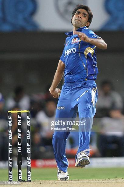 Mumbai Indian bowler Munaf Patel bowls during IPL5 cricket match between Mumbai Indians and Deccan Chargers at YSR Stadium on April 9 2012 in...