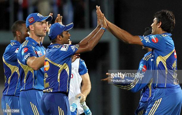Mumbai Indian bowler Munaf Patel celebrating with teammates after taking the wicket of Deccan Chargers batsman Daniel Christian during IPL5 cricket...