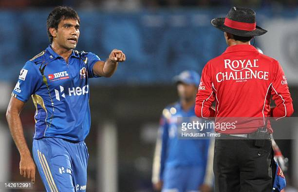 Mumbai Indian bowler Munaf Patel speaks with the umpire about the wicket of Deccan Chargers captain Kumar Sangakkara during IPL5 cricket match...
