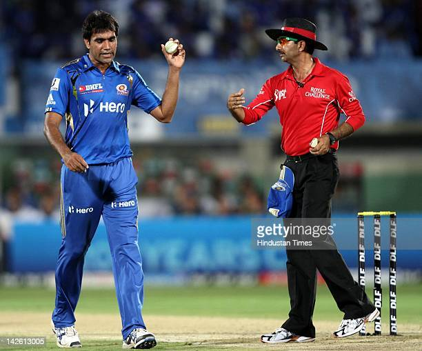 Mumbai Indian bowler Munaf Patel throws the ball after Deccan Chargers batsman Sangakkara was bowled out during IPL5 cricket match between Mumbai...