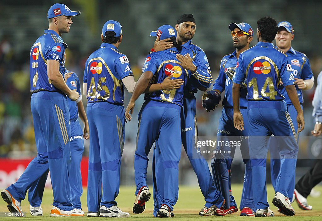 Mumbai Indian captain Harbhajan Singh (C) hugs Ambati Rayadu to celebrate with teammates after getting Chennai Super Kings batsmen Francois Du Plessis (Not seen in picture) runout during inaugural cricket match of Indian Premier League 2012 played between Mumbai Indians And Chennai Super Kings batmen at M.A.Chidambaram Stadium on April 4, 2012 in Chennai, India.