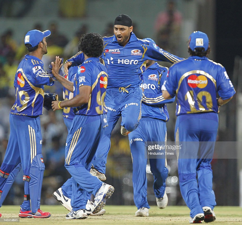 Mumbai Indian captain Harbhajan Singh jumps to celebrating with teammates after taking wicket of Chennai Super Kings batsmen Ravichandran Ashwin (Not seen in picture) during inaugural cricket match of Indian Premier League 2012 played between Mumbai Indians And Chennai Super Kings batmen at M.A.Chidambaram Stadium on April 4, 2012 in Chennai, India.