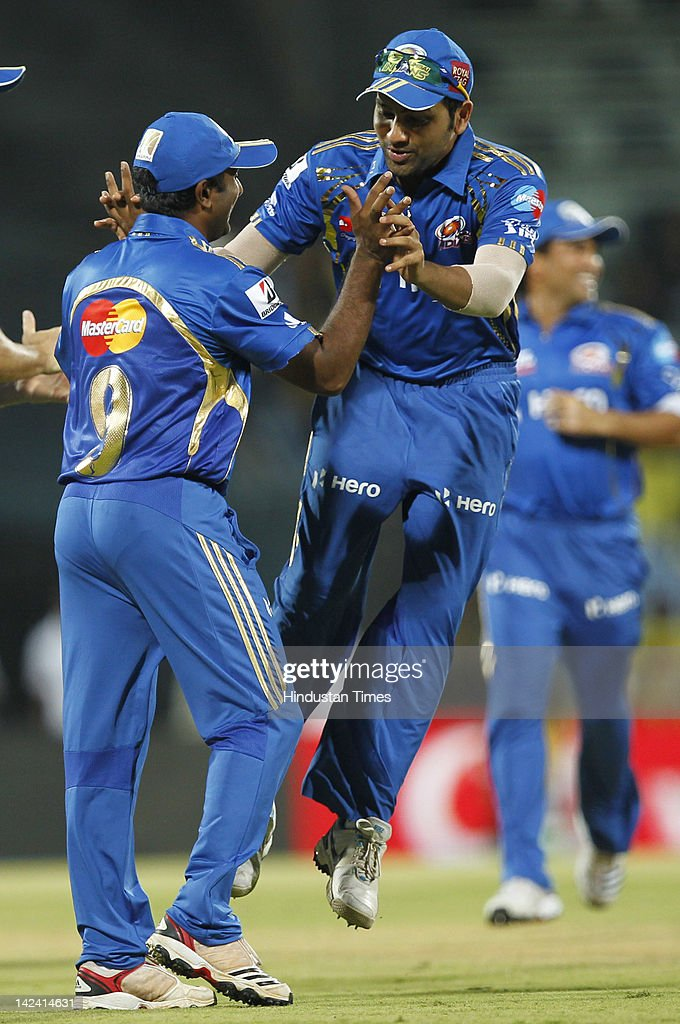Mumbai Indian player Ambati Rayadu (L) celebrates with teammate <a gi-track='captionPersonalityLinkClicked' href=/galleries/search?phrase=Rohit+Sharma&family=editorial&specificpeople=815520 ng-click='$event.stopPropagation()'>Rohit Sharma</a> (R) after getting Chennai Super Kings batsmen Francois Du Plessis (Not seen in picture) runout during inaugural cricket match of Indian Premier League 2012 played between Mumbai Indians And Chennai Super Kings batmen at M.A.Chidambaram Stadium on April 4, 2012 in Chennai, India.