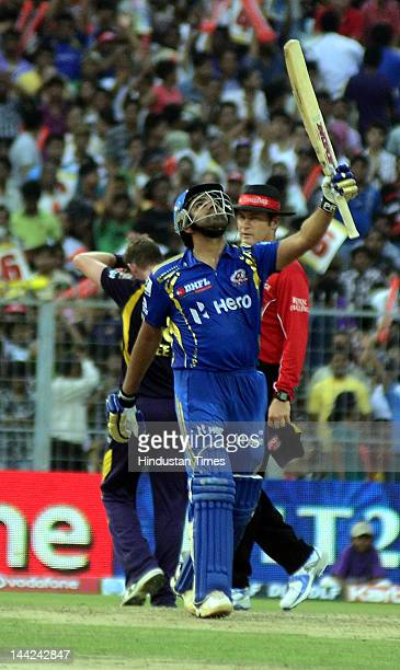 Mumbai Indian Player Rohit Sharma acknowledges the crowd after his century during the match between Kolkata Knight Rides and Mumbai Indians at Eden...