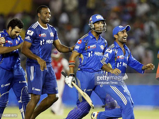 Mumbai Indians batsman Ambatti Rayadu celebrating with teammates Dinesh Karthik Keiron Pollard and Rohit Sharma after winning their match against...