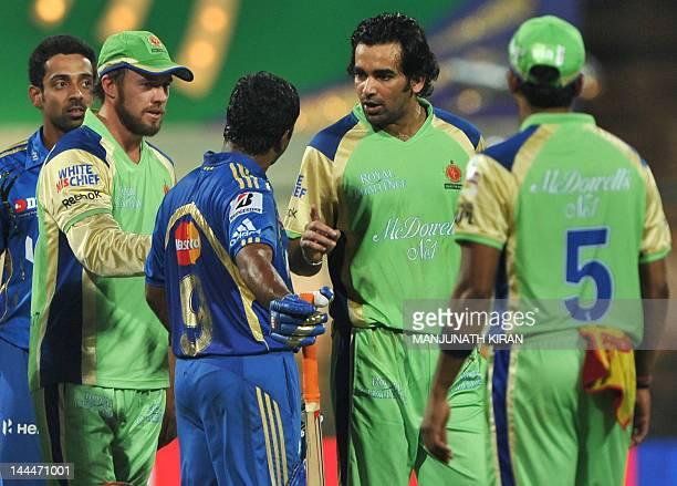 Mumbai Indians batsman Ambatti Rayadu discusses with Royal Challengers Bangalore cricketers Zaheer Khan and A B De Villers following a confrontation...