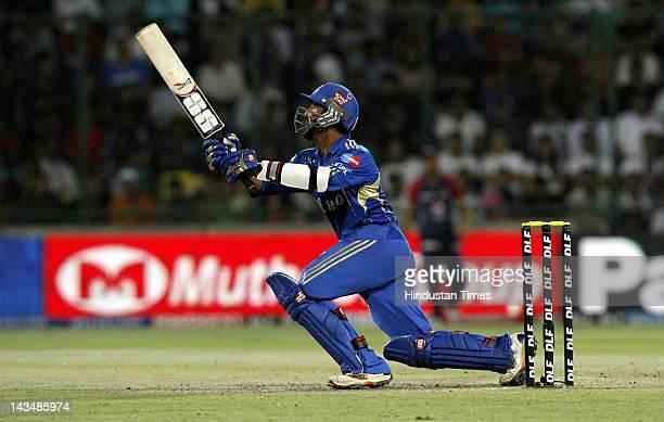 Mumbai Indians batsman Dinesh Karthik plays a shot during IPL 5 T20 cricket match played between Delhi Daredevils and Mumbai Indians at Ferozshah...