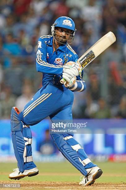 Mumbai Indians batsman Harbhajan Singh plays a shot during the IPL T20 cricket match between Mumbai Indians and Rajasthan Royals at Wankhade stadium...
