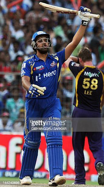 Mumbai Indians batsman Rohit Sharma celebrates after scoring a century during the IPL Twenty20 cricket match between Kolkata Knight Riders and Mumbai...