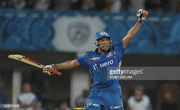 Mumbai Indians batsman Rohit Sharma celebrates after winning shot on April 9 2012 during the IPL Twenty20 cricket match against the Deccan Chargers...