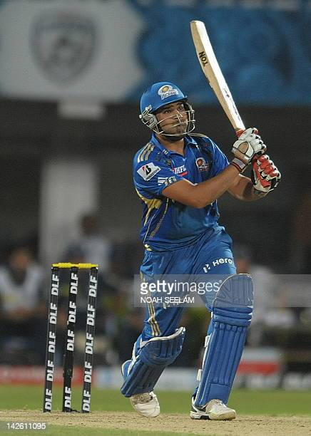 Mumbai Indians batsman Rohit Sharma play a winning shot on April 9 2012 during the IPL Twenty20 cricket match against the Deccan Chargers at the Dr...