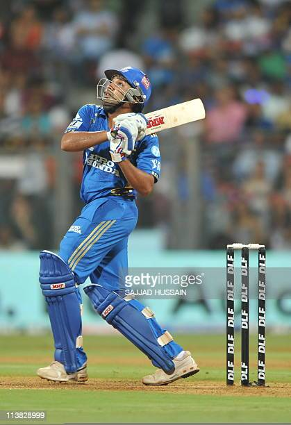 Mumbai Indians batsman Rohit Sharma plays a shot during the IPL Twenty20 cricket match between Mumbai Indians and Delhi Daredevils at The Wankhede...