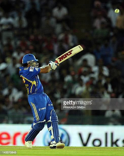 Mumbai Indians Batsman Rohit Sharma plays a shot during the IPL Twenty20 cricket match between Kings XI Punjab and Mumbai Indians at PCA Stadium in...