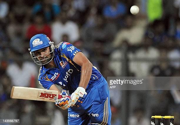 Mumbai Indians batsman Rohit Sharma plays a shot during the IPL Twenty20 cricket match between Mumbai Indians and Deccan Chargers at the Wankhede...
