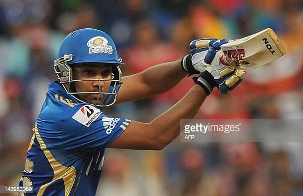 Mumbai Indians batsman Rohit Sharma plays a shot during the IPL Twenty20 cricket match between Mumbai Indians and Chennai Super Kings at the Wankhede...
