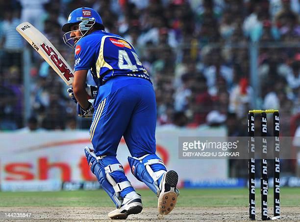 Mumbai Indians batsman Rohit Sharma plays a shot during the IPL Twenty20 cricket match between Kolkata Knight Riders and Mumbai Indians at The Eden...