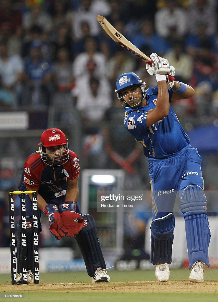 Mumbai Indians batsman <a gi-track='captionPersonalityLinkClicked' href=/galleries/search?phrase=Rohit+Sharma&family=editorial&specificpeople=815520 ng-click='$event.stopPropagation()'>Rohit Sharma</a> plays a shot during the IPL T20 match between Mumbai Indians vs Delhi Daredevils at Wankhede Stadium on April 16, 2012 in Mumbai, India. Batting first after losing the toss Mumbai Indians posted a target of 93 to win for Delhi Daredevils.