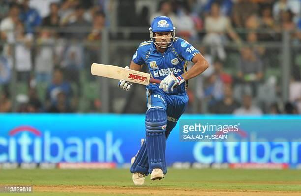 Mumbai Indians batsman Rohit Sharma runs between the wickets during the IPL Twenty20 cricket match between Mumbai Indians and Delhi Daredevils at The...