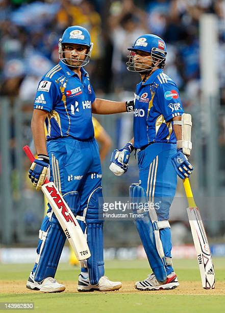 Mumbai Indians batsman Sachin Tendulkar chats with his teammate Rohit Sharma during their IPL T20 match played at Wankhede Stadium on May 6 2012 in...