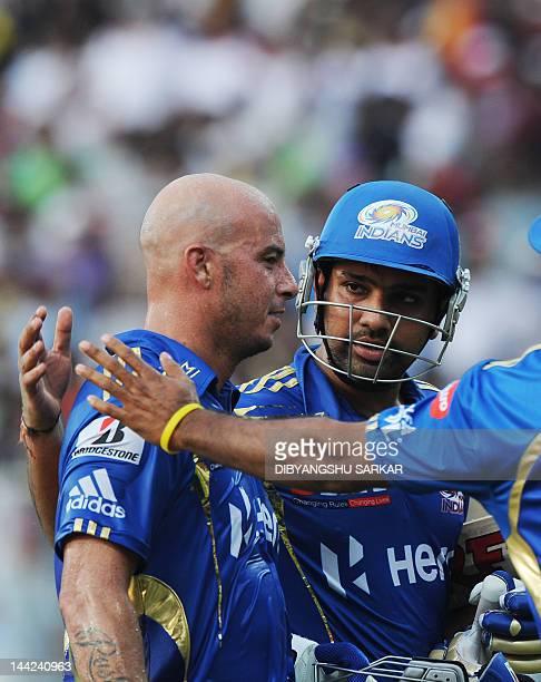 Mumbai Indians batsmen Herschelle Gibbs and Rohit Sharma interact as they walk back after their innings during the IPL Twenty20 cricket match between...