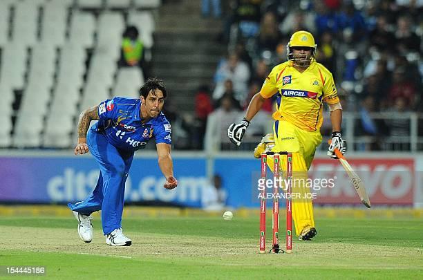 Mumbai Indians bowler Mitchell Johnson runs out Chennal Super Kings batsman Doug Bollinger on October 20 2012 during a Group B Champions League T20...