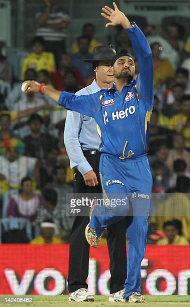 Mumbai Indians captain and bowler Harbhajan Singh delivers a ball past umpire Simon Taufel to Chennai Super Kings batsman Murali Vijay during the IPL...