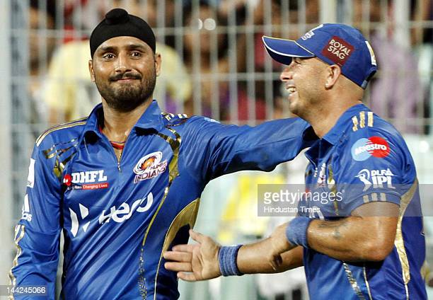 Mumbai Indians Captain Harbhajan Singh with Herschelle Gibbs celebrating after winning the match against Kolkata Knight Riders at Eden Gardens on May...