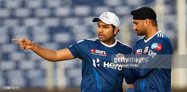 Mumbai Indians captain Harbhajan Singh with teammate Rohit Sharma during the net practice session at at Subrata Roy Sahara Stadium on May 2 2012 in...