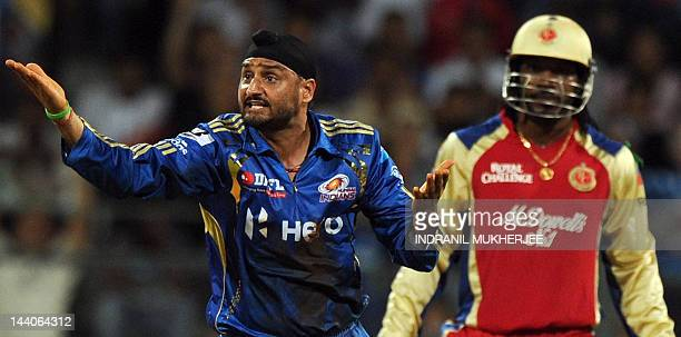 Mumbai Indians cricketer Harbhajan Singh appeals unsuccessfully against Royal Challengers Bangalore batsman Chris Gayle during the IPL Twenty20...