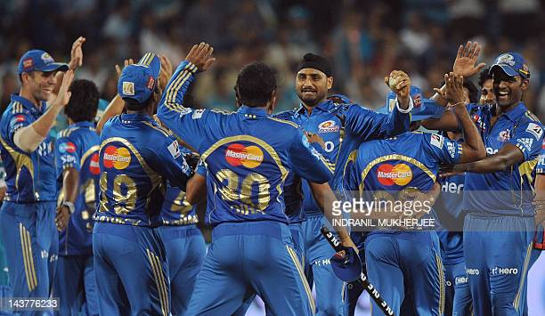 Mumbai Indians' cricketers celebrate their victory with captain Harbhajan Singh after winning the IPL Twenty20 cricket match between Pune Warriors...