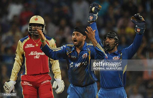 Mumbai Indians cricketers Harbhajan Singh and Dinesh Karthik appeal unsuccessfully against Royal Challengers Bangalore batsman Chris Gayle during the...