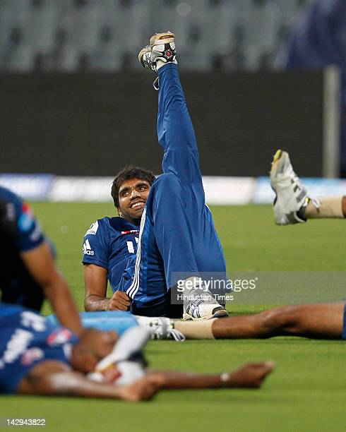 Mumbai Indians player Munaf Patel stretches during the practice section at Wankhede Stadium on April 15 2012 in Mumbai India The Mumbai Indians will...