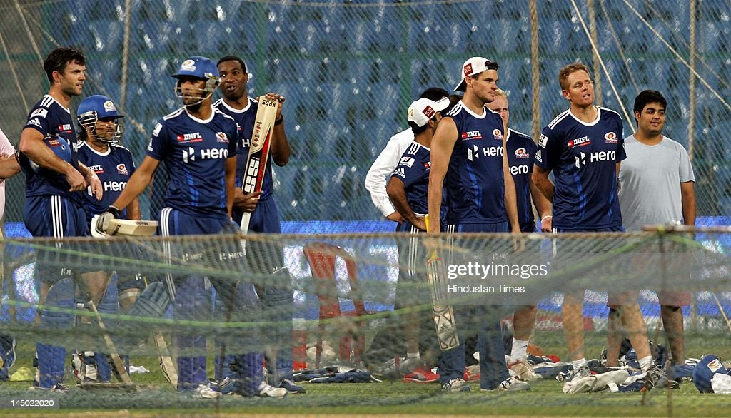 Mumbai Indians players along with Anant Ambani (R), son of Mukesh Ambani and owner of Mumbai Indians during the team practice session at M Chinnaswamy stadium on May 22, 2012 in Bangalore, India. Chennai Super Kings will play Mumbai Indians in eliminator 1 on May 23, 2012. The winner of this tie will then play Delhi Daredevils to decide the finalist. Kolkata Knight Riders have already qualified for final.