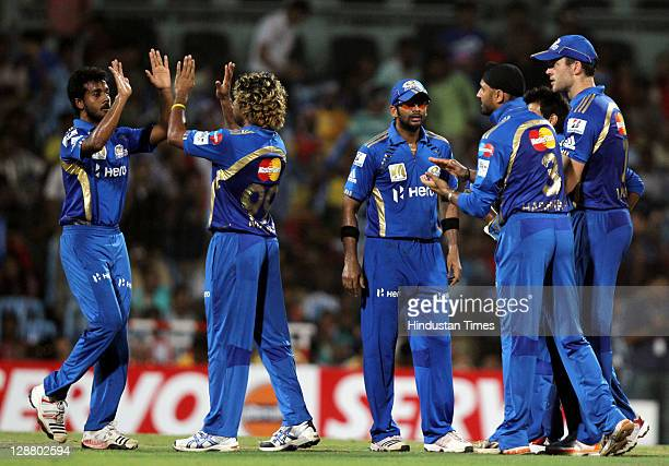 Mumbai Indians players celebrate after the dissmisal of Royal Challengers Bangalore batsman Tilakratne Dilshan during the Champions League Twenty20...