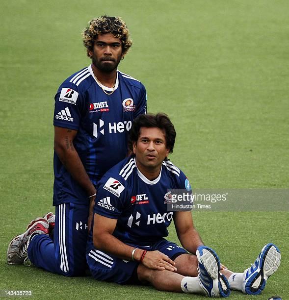 Mumbai Indians players Sachin Tendulkar and Lasith Malinga during the practice session at Ferozshah Kotla ground on April 26 2012 in New Delhi India...