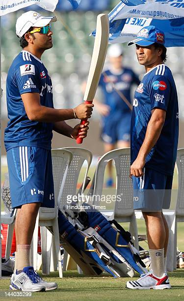 Mumbai Indians players Sachin Tendulkar and Rohit Sharma having chat during the net practice session at Wankahde Stadium on May 8 2012 in Mumbai...