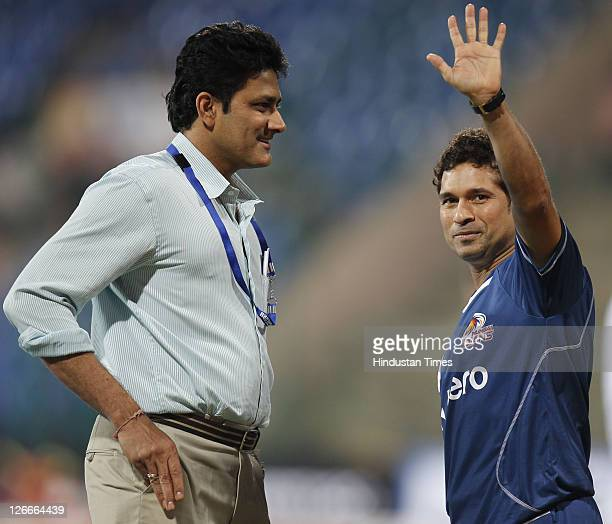 Mumbai Indian's Sachin Tendulkar and Anil Kumble before the Champions League Twenty20 Group A match between Mumbai Indians and Trinidad Tobago at M...