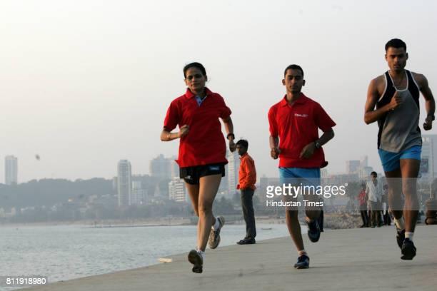 Mumbai Marathon 2009 Leelamama Alphonso Dinesh Yadav and Jitendra Gupta practices for Mumbai Marathon at Marine Drive in Mumbai on Thursday