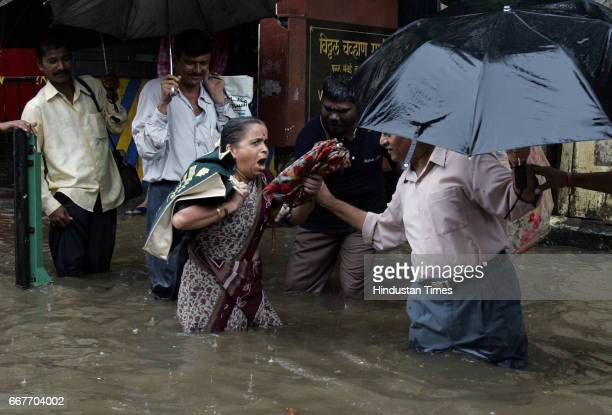 Mumbai Monsoon Floods As people walked in knee deep water at Parel on Friday a woman is being helped by men after she sprained her ankle courtesy...