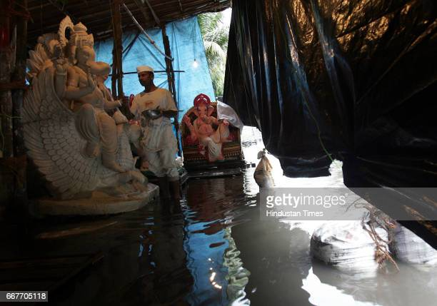 IDOL Mumbai Monsoon Floods Sculpture With Ganesh Chaturthi just one month away artist Machinder Kumbhar seemed unfazed by the knee deep water in his...