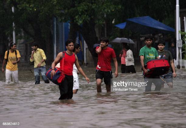 Mumbai Monsoon Floods Young Boys Walk Through On Their Way To Station To Catch The Train To Surat In The Flooded Water Due To Heavy Rains On Saturday...