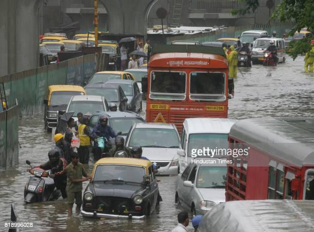 Mumbai Monsoon Rain BMC Truck Taxi Motorcycle Helmet Heavy rain at Hindmata Parel in Mumbai on Saturday