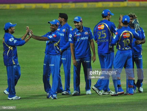 Mumbai players celebrate capturing the wicket of Alviro Petersen of the Lions for 14 runs during the Karbonn Smart CLT20 match between Highveld Lions...