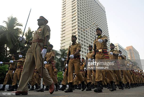 Mumbai policemen march pass the Trident hotel during a parade to commemorate the second anniversary of the November 2008 terror attacks in Mumbai on...