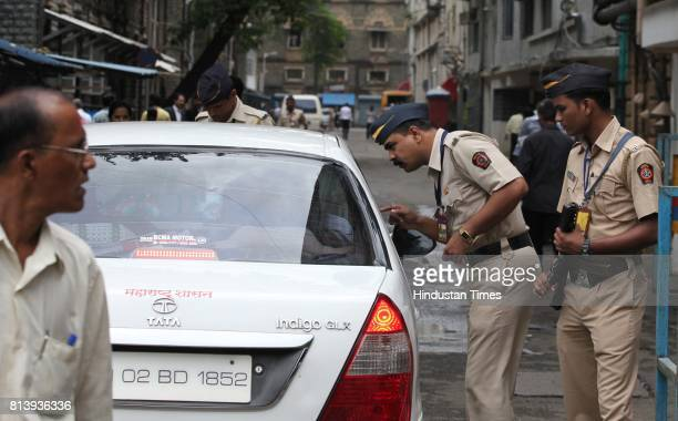 Mumbai policemen stand guard outside the High Court in Mumbai on Wednesday