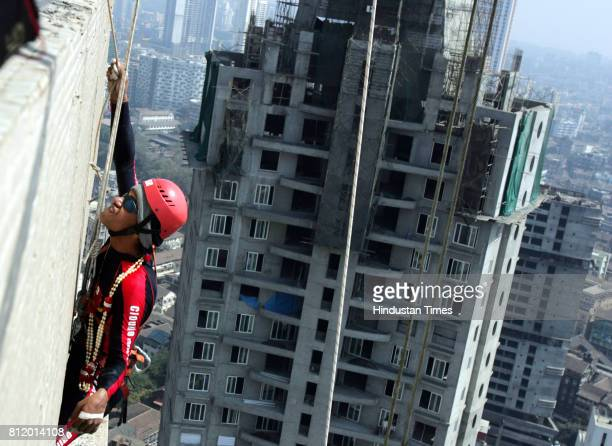 Mumbai police's martial arts trainer Gurav Sharma climbing a 45storey and 153 meters tall Shreepati arcade building at Nana chowk on republec day to...
